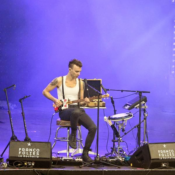 Israeli singer-songwriter Asaf Avidan performs on stage in La Rochelle on July 13, 2014 during the Francofolies Music Festival.
