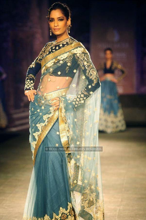 Krishna Somani walks the ramp for Anju Modi on Day 2 of India Couture Week, 2014, held at Taj Palace hotel, New Delhi.