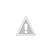 a square vase with black painted stripes and washi tape gold stripes.