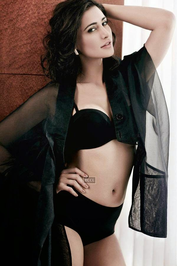 Black is always in demand as actress Nargis Fakhri wears a sensuous lingerie which enhances her beauty.