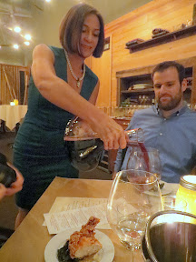 April flexing her incrediblly toned arms as she pours from the decanter the 2011 Hawks View La Baleine (Whale)