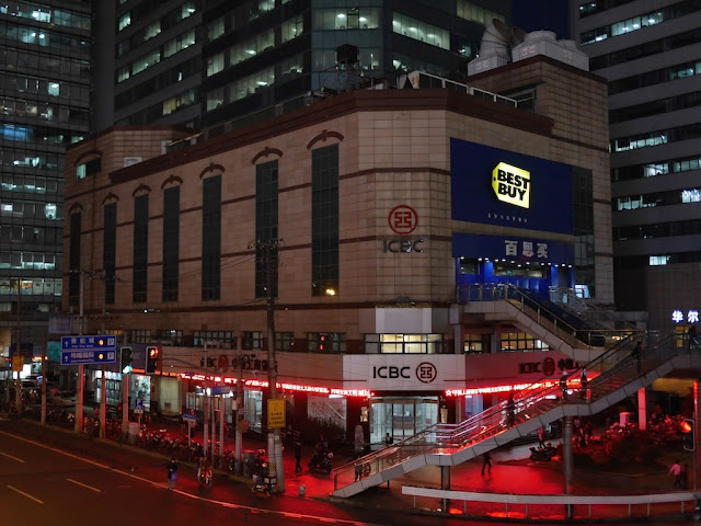 Best Buy sign lit up at night at the old Best Buy store in Shanghai, China