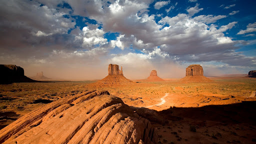 A Building Sandstorm Behind the Two Mittens, Monument Valley, Utah.jpg