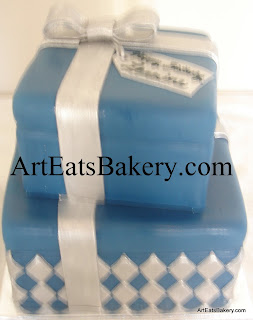 Two tier square blue and silver fondant presents creative custom birthday cake design with diamonds, bow and edible name tag