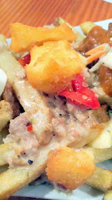 Poutino by Chef Rick Gencarelli of Lardo with herbs, parmesan, Italian Sausage gravy, Mama Lil's peppers and fried Vampire Slayer Curds, for Curse of the Haunted Curds, a Poutine Pop-up with proceeds to the D Wright Way Foundation