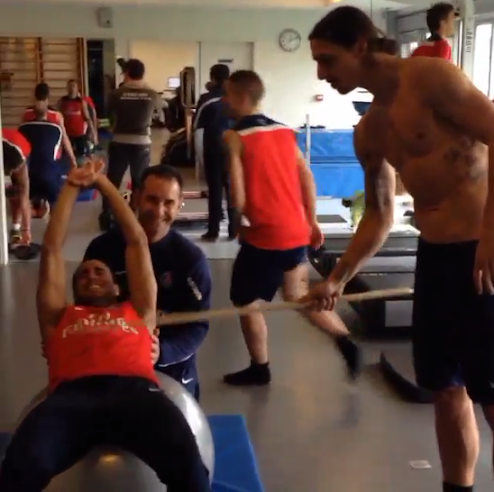 Zlatan Ibrahimovic helps PSG teammate Lucas out in the gym by hitting with a stick during a workout