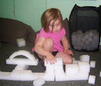 Child works to balance blocks.