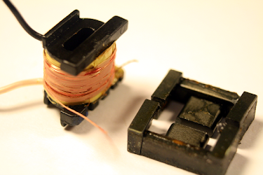Removing the ferrite core and insulation reveals the double-stranded primary winding.