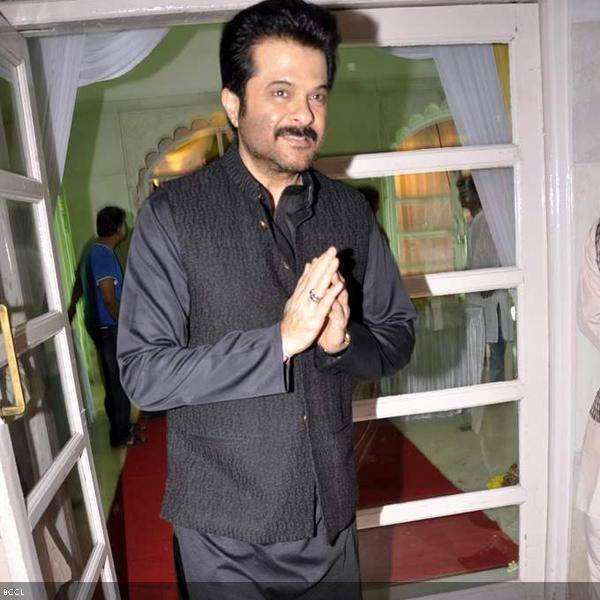 Anil Kapoor arrives at Ramesh and Seema Deo's 50th wedding anniversary, held at ISKCON, in Mumbai, on July 1, 2013. (Pic: Viral Bhayani)
