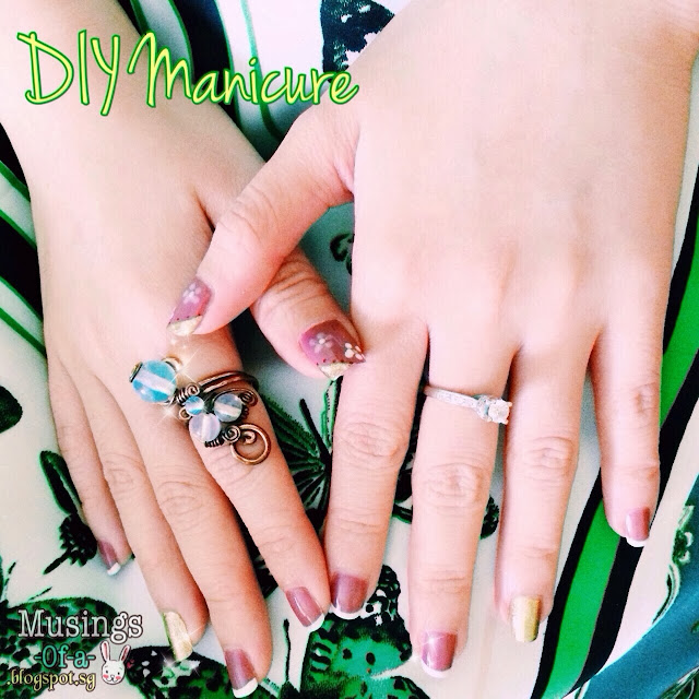 French Tips Manicure with fourth finger in gold sparkles + moonstone ring + diamond solitaire ring