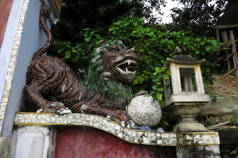 Lion of concrete and glass bottles at Linh Ung Pagoda
