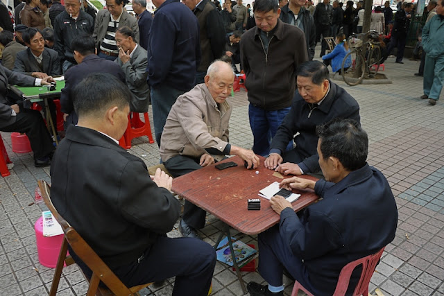 men playing a dominoes game in Changsha, China
