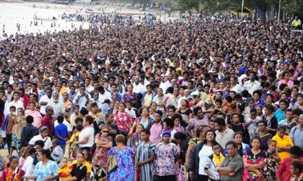 50,000 Adventist Church members and friends standing on the shore watching the baptism.