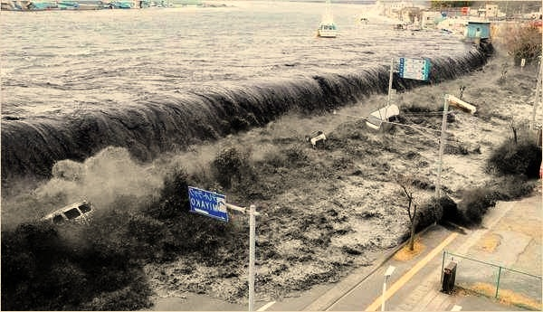 The tsunami's wave crashed over a street after an earthquake struck the area on Friday, Miyako, Northeastern Japan