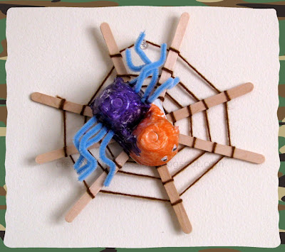 Craft stick spider web and Egg carton Spider