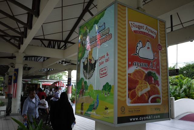 advertisement for Nuget Ayam chicken nuggets at the Kuala Lumpur Bird Park