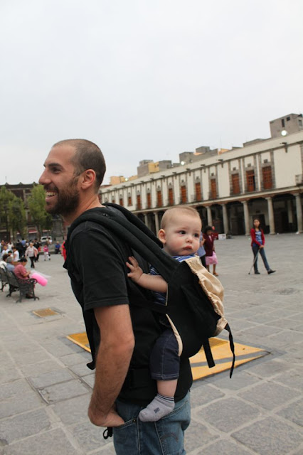 walking with a baby carrier in Mexico City's centro historico