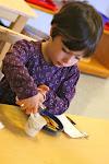 LePort Montessori Preschool Toddler Program Irvine Spectrum - girl serving herself, snack time