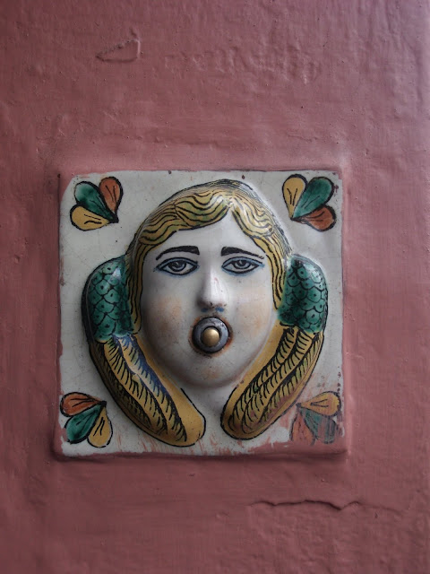 Mexican ceramic plate for a doorbell shaped like an angel's face