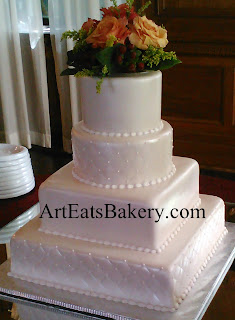 Four tier square ivory pearl fondant unique modern wedding cake with diamond quilt and fresh rose topper
