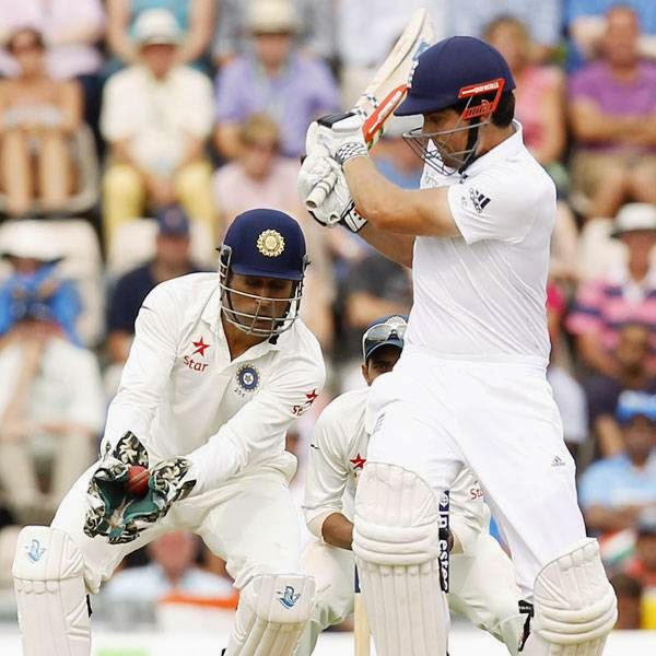England's Captain Alastair Cook (R) is caught out by India Captain and wicketkeeper Mahendra Singh Dhoni (L) for 95 runs during the first day of the third cricket Test match between England and India at The Ageas Bowl cricket ground in Southampton on July 27, 2014.