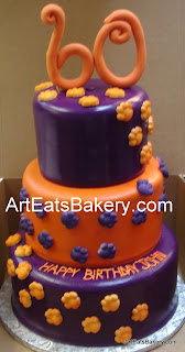 Three tier custom purple and orange fondant Clemson tiger paw 60th birthday cake with topper