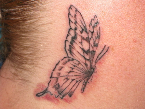 neck butterfly tattoos
