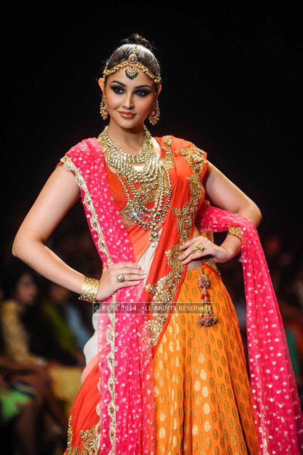 A model showcases a creation by Golecha Jewels on Day 3 of India International Jewellery Week (IIJW), 2014, held at Grand Hyatt, in Mumbai.<br /> <br /> <br />