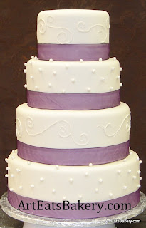Four tier custom fondant wedding cake with sugar pearls and white royal icing scroll design