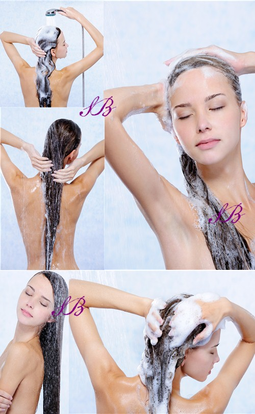 Stock Photo: Girl washing her long hair