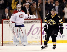 Brad Marchand skates to the bench after scoring a goal