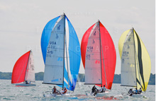 J/70 one-design sailboats- sailing downwind under spinnaker