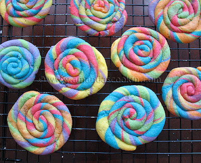 An overhead photo of St. Patrick\'s day rainbow cookies on a cooling rack.