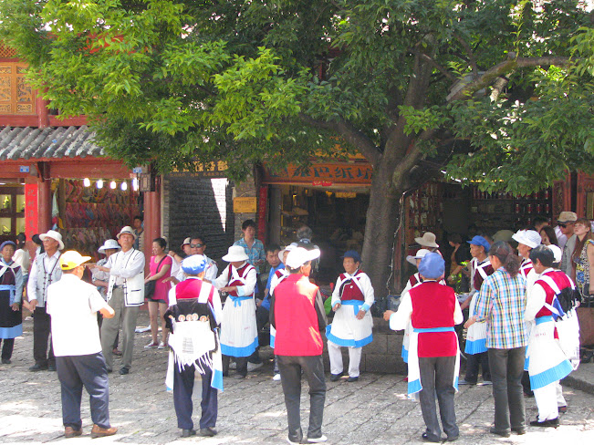 The Naxi people gather and are ready to burst into dance for the Torch Festival that usually takes place in August