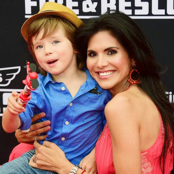 Actress Joyce Giraud arrives to the premiere of 'Planes: Fire & Rescue' with her son Leonardo Ohoven at the El Capitan Theater in the Hollywood section of Los Angeles, California, July 15, 2014.