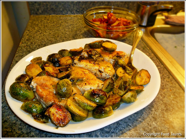 Chicken with Roasted Brussel Sprouts and Mustard Sauce along with Roasted Potatoes and Carrots