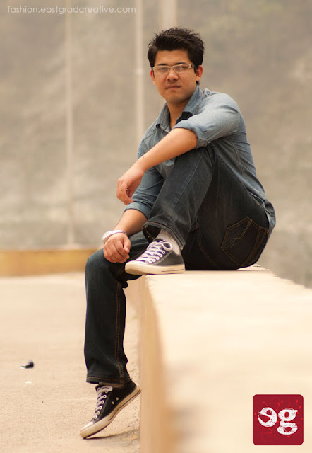 Denim shirt, black denim jeans paired with a pair of converse for casual wear.