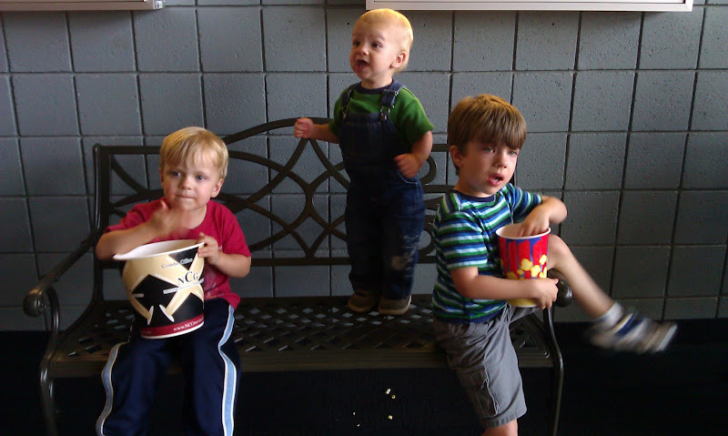 Three boys at the theater