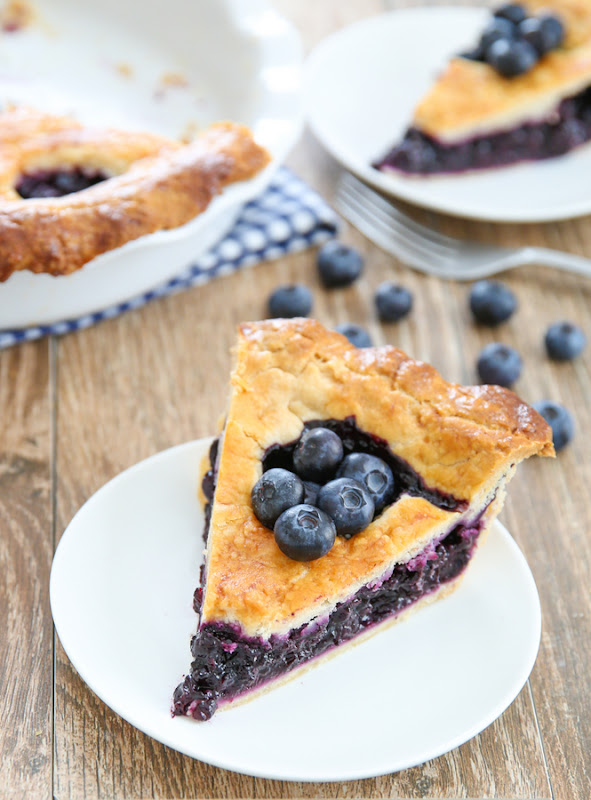 overhead photo of a slice of blueberry pie