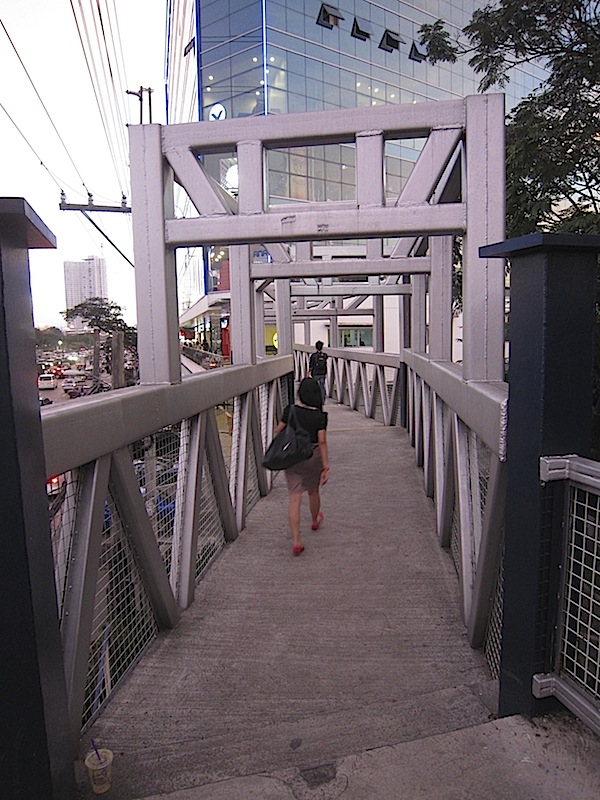 extension of footbridge leading to the Regis Center