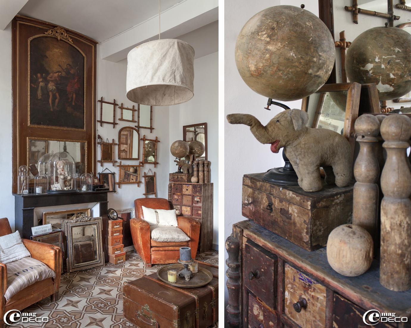 Dans un ancien appartement à Uzès, un trumeau décoré d'une peinture religieuse, lustre en bâche, boutique 'Clair de Lune', meuble de métier, globe, éléphant en peluche et jeu de quilles en bois