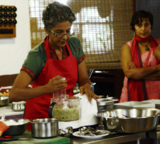 Archana Saraf watches as Dr. Nandita works the food processor