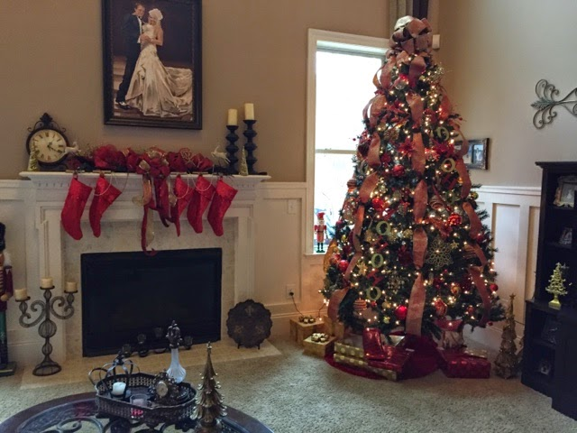this is our 9 ft main tree in our living room with all red and gold ornaments it was the subject of my recent post of christmas tree decorating tips - 9 Ft Christmas Trees