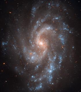 Fotografía de la galaxia espiral NGC 5584, obtenida por el telescopio Hubble