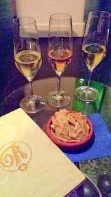 Champagne Flight and homemade Cheez Its at Remedy Wine Bar