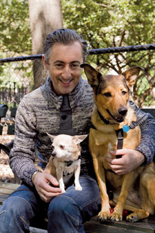 Alan Cumming and two dogs outside