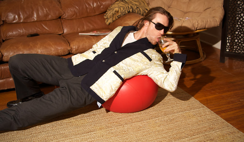 Navy Drinking Jacket drinking on exercise ball