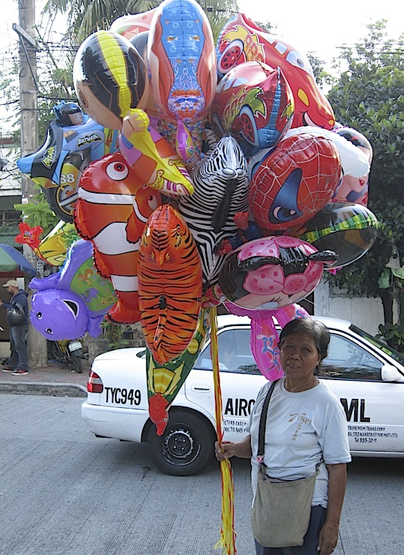 lady selling balloons at the Immaculate Heart of Mary Parish church