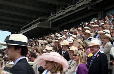 People in the Richmond Enclosure grandstand at Glorious Goodwood in England