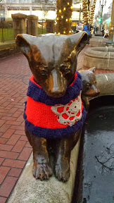 "#UglySweaterPDX campaign, 2013: Some of downtown's most iconic sculptures will don their holiday finery for the season. In the Pioneer District on Southwest Yamhill and Morrison streets (between Fifth and Sixth avenues), you'll see Animals in Pools, Allow Me (aka ""Umbrella man"") and Kvinneakt dressed up in festive ugly sweaters."